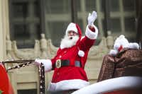 In this file photo, Santa waves to the crowd during the annual downtown Dallas Christmas parade.