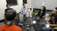 Students at the University of Texas at Arlington meet NAO, a robot designed to be an interactive companion.(<p>Louisa Kellie</p>/University of Texas at Arlington)