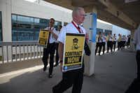 Spirit Airlines pilots and members of the Air Line Pilots Association, International, picket outside DFW Airport's Terminal E on Friday.(Mike Healey/Air Lines Pilots Association, International)