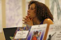 Sara Mokuria, co-founder of Mothers Against Police Brutality, listens to a speaker during Faith in Texas' Live Free DFW event at Concord Baptist Church in Dallas.(Jae S. Lee/Staff Photographer)