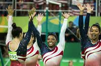 Simone Biles of the United States (center) waves to the crowd with her teammates (from left) Alexandra Raisman, Lauren Hernandez, Madison Kocian and Gabrielle Douglas after winning the women's team gold medal at the 2016 Summer Olympic Games in Rio de Janeiro, Brazil.(2016 File Photo/Smiley N. Pool)