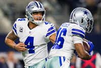 Dallas Cowboys quarterback Dak Prescott hands off to running back Alfred Morris during the first quarter of Sunday night's game against the Philadelphia Eagles at AT&T Stadium in Arlington.(Ashley Landis/Staff Photographer)