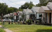 Homes line the street in the 2300 block of Elsie Faye Heggins St. in Dallas on Monday, July 10, 2017.(David Woo/Staff Photographer)
