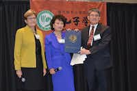 State Reps. Linda Koop (left) and Angie Chen Button present Dr. Ming Dong Gu with a proclamation honoring the 10th anniversary of the Confucius Institute at UTD. (University of Texas at Dallas)
