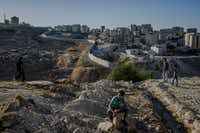 The separation barrier divides Israeli territory and the Shuafat camp in East Jerusalem, in the West Bank, June 11, 2016.(Daniel Berehulak/The New York Times)