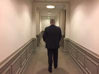 Dallas lawyer Steve Badger walks the halls of the Texas Capitol trying to convince lawmakers to approve a roofer's licensing bill.