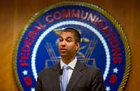 Ajit Pai, chairman of the Federal Communications Commission, talks at the federal agency's headquarters in Washington on June 23. The FCC announced Tuesday that it plans to dismantle landmark regulations that ensure equal access to the internet, clearing the way for companies to charge more and block access to some websites.(2017 File Photo/The New York Times)