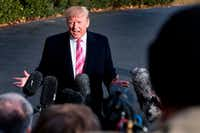 President Donald Trump talks to reporters before his departure from the White House on Tuesday.(Jim Watson/Agence France-Presse)