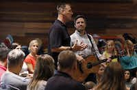 Todd Wagner, left, senior pastor at Watermark Community Church, and Jon Abel, worship director, talk to staffers during their once-a-week Tuesday staff prayer gathering in Dallas.(David Woo/Staff Photographer)