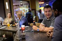 Chris Auwarter (second right right), president of Evantage Inc., talks with Eric Anagho as they have drinks at Main Event in Frisco.(G.J. McCarthy/Staff Photographer)