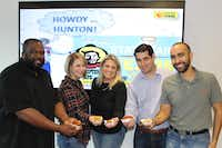 Every year, on opening day of the State Fair of Texas, Hunton & Williams celebrates with an all-office lunch of deep-fried corny dogs, pickles, Oreos, Snickers, cheesecake and Twinkies.(Hunton & Williams)