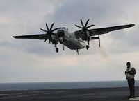 This U.S. Navy C-2 Greyhound, shown here in March 2017 in waters east of the Korean Peninsula, is similar to the plane that crashed Wednesday in the Pacific Ocean.(Lee Jin-man/AP File)