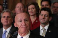 U.S. House Ways and Means Committee Chairman Rep. Kevin Brady, R-The Woodlands, speaks as House Majority Leader Rep. Kevin McCarthy (left) and Speaker of the House Paul Ryan listen during an event at the Capitol to celebrate the passing of the tax reform bill Nov. 16, 2017. (Alex Wong/Getty Images)