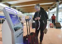 Ann Allen uses a Southwest Airlines kiosk to print luggage tags at Dallas Love Field Wednesday, November 22, 2017. She was passing through Dallas from El Paso, Texas. (Ron Baselice/The Dallas Morning News)(Staff Photographer)