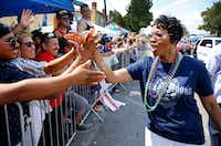 New Dallas Police Chief U. Renee Hall greeted the crowd as she walked the length of the Texas Freedom Parade on Sept. 17. (Tom Fox/Staff Photographer)