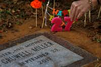 """Angela Norris places candles on her daughter Taylor Gruwell's grave at Greenwood Memorial Park in Fort Worth on Wednesday, the same day Gruwell would have turned 27.(<p><span style=""""font-size: 1em; background-color: transparent;"""">Jae S. Lee</span></p>/Staff Photographer)"""