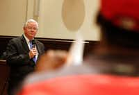 Texas Republican Congressman Joe Barton listens as Chuck Dandridge asks questions during a town hall meeting at Mansfield City Hall on April 13.(David Woo/Staff Photographer)