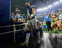 Dallas Cowboys quarterback Dak Prescott (4) walks off the field after a 28-6 loss against the Los Angeles Chargers on Thursday at AT&T Stadium.(Ashley Landis/Staff Photographer)