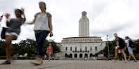 Students cross the University of Texas at Austin campus near the school's iconic tower. Graduate students fear that the U.S. House's plan to reform the federal tax code could make advanced degrees unaffordable.(The Associated Press/2012 File Photo)