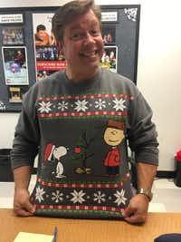 B.J. Cleveland wearing a Charlie Brown shirt to wear at the Dallas Children's Theater box office to match the company's show, 'A Charlie Brown Christmas.' DCT is also presenting 'Frosty & Friends' on its second stage.(Nancy Churnin)