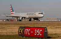 An American Airlines Airbus A321 lands on Runway 17C at DFW International Airport on Monday. (Ron Baselice/Staff Photographer)