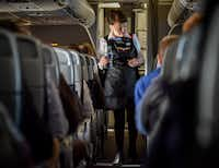 "Bette Nash, checking on her American Airlines passengers, still brings the people on her flight ""a little love and a little attention."" (Bill O'Leary/The Washington Post)"