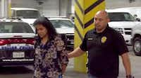 Sini Mathews, the mother of Sherin Mathews, is escorted by police during her transfer to Dallas County jail in Dallas, Friday, Nov. 17, 2017.((NBC5)/KXAS-TV)