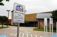 """The Flower Mound Police Department has added two """"Online Exchange Zone"""" signs in the front of its parking lot."""