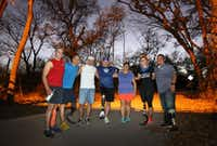 From left: Charlie Garcia, Mike Dimas, Jerry Fernandes, Larry Olchak, Yolanda Dimas, Jen Brigham and Ricardo Mendoza are part of the SMU Cox School of Business relay teams. They represent the nonprofit Happy Feat Foundation for the BMW Dallas Marathon. A two-legged runner from one team is paired with an amputee runner from the other. (Louis DeLuca/Staff Photographer)