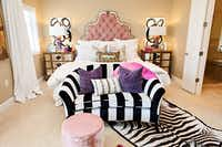 Abbe Fenimore went for bold black and white stripes and a dramatic black and white rug to add interest to this bedroom anchored by a romantic blush pink headboard. 05022015xARTSLIFE(Melanie Johnson Photography/Melanie Johnson Photography)