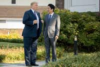 U.S. President Donald Trump met with Japanese Prime Minister Shinzo Abe at Kasumigaseki Country Club, in Kawagoe, Japan. (Andrew Harnik/The Associated Press)