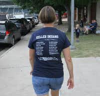 A Keller Indians softball supporter made her way toward the front gate as part of a large contingency that made the trip to Austin in June to support the Indians in their quest for back-to-back state championships. Keller defeated Austin Bowie to win the title.(Steve Hamm/Special Contributor)