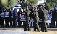 Border Patrol pallbearers carry Border Patrol agent Rogelio Martinez to a graveside service at Restlawn Cemetery on Saturday in El Paso.(Mark Lambie/The El Paso Times)