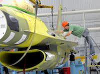 <p>The last F-16, RA-28, was lifted by an overhead crane and moved to a paint station at Lockheed Martin Aeronautics in Fort Worth on April 10, 2017. RA-28 is the 3,630th F-16 fighter to be built in Fort Worth and 4,588th to be built worldwide. It's the last F-16 produced at the facility.</p>(Max Faulkner/Fort Worth Star-Telegram)