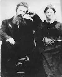 Charles and Caroline Ingalls in the late 1870s or early 1880s. Caroline is wearing a comb in her hair, perhaps a gift from her daughters that is described in <i>Pioneer Girl</i>. From <i>Prairie Fires: The American Dreams of Laura Ingalls Wilder</i>.(Laura Ingalls Wilder Memorial Society/Metropolitan)