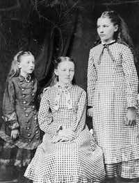 The first known photograph of the three eldest Ingalls sisters, taken around 1879 or 1880. From left: Carrie, Mary and Laura. Carrie is believed to be wearing a string of American Indian beads, perhaps those collected by her sisters on the day she was born. From<i> Prairie Fires: The American Dreams of Laura Ingalls Wilder</i>.(Laura Ingalls Wilder Home & Museum/Metropolitan Books)