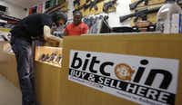 In 2014, Jon Rumion bought two guns at Central Texas Gun Works in Austin using bitcoin. (Eric Gay/The Associated Press)