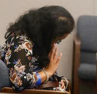 Sini Mathews, mother of Sherin Mathews, waits for her and her husband's hearing to resume in Judge Cheryl Lee Shannon's courtroom on Wednesday.(David Woo/Staff Photographer)