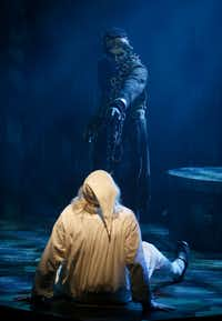 Brad Leland as Ebenezer Scrooge (bottom) and Will Power as Jacob Marley perform during a dress rehearsal of a holiday production of <i>A Christmas Carol.</i>(Jae S. Lee/Staff Photographer)