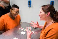 Inmates Sheniqua Miller, 23, (left) and Stacy Jensen, 38, play cards in their unit at the Burnet County Jail. Both women are facing drug charges; Miller has been jailed there since October and Jensen has been in nearly six months. Jensen's bond is set at $300,000. (Ashley Landis/Staff Photographer)