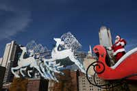 Santa Claus takes in the sights along the parade route during the 28th annual Children's Health Holiday Parade through downtown Dallas on Dec. 5, 2015.(Andy Jacobsohn/Staff Photographer)