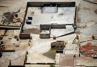 An aerial photograph shows the building foundations that remained at the former Exide Technologies plant as of April 3, 2015, in Frisco.(G.J. McCarthy/Staff photographer)