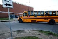A school bus drops off students off at W.E. Greiner Exploratory Arts Academy in Dallas.(Nathan Hunsinger/Staff Photographer)