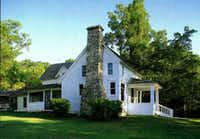 This simple white farm house in Mansfield, Mo., is where Laura Ingalls Wilder wrote the popular Little House books. (Wilder Home Association)