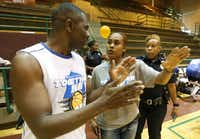 "Pastor Richie Butler of St. Paul United Methodist Church talks with basketball coach, Dallas Police Sr. Corporal Tramese Andrews, center, as the Police and local pastors hold the ""Together We Ball"" event to promote togetherness in the community at Cobb Fieldhouse in Dallas on Sunday, August 9, 2015.(Louis DeLuca/Staff Photographer)"