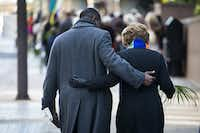 St. Paul United Methodist Church pastor Rev. Richie Butler walks arm-in-arm with First Presbyterian Church of Dallas associate pastor Rev. Wendy Fenn as the two congregations merge into one Palm Sunday parade at Thanks-Giving Square in downtown Dallas on Sunday, March 20, 2016.(Smiley N. Pool/Staff Photographer)
