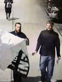 Two people from the group were seen carrying a banner at Park Cities Plaza after midnight Saturday.(SMU Police Department)