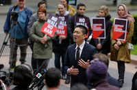 Hawaii Attorney General Doug Chin talks to reporters on May 15 outside a federal courthouse in Seattle, where a lawsuit was filed to halt enforcement of President Donald Trump's travel ban.(The Associated Press/2017 File Photo)