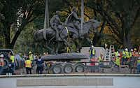 Workers load a statue of Confederate Gen. Robert E. Lee onto a trailer on Sept. 14 at Lee Park in Uptown. The final cost to taxpayers for the statue's removal will approach half a million dollars. The park has since been renamed.(Staff Photographer/Jae S. Lee)
