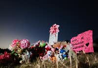 A makeshift memorial of flowers, stuffed toys and written messages stands near where the body of 3-year-old Sherin Mathews, 3, was found in October, weeks after she was reported missing by her adoptive parents.(Staff Photographer/Rose Baca)